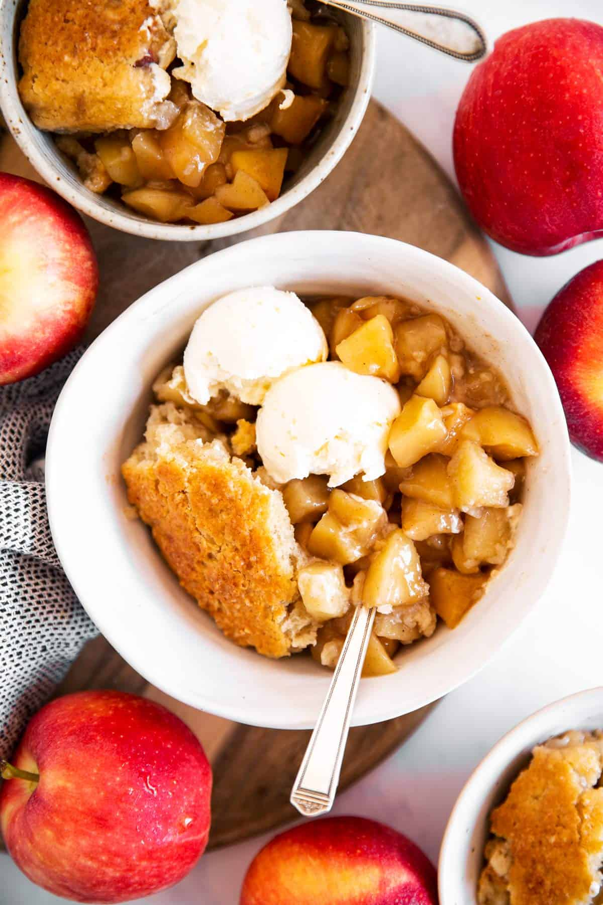 overhead view on three bowls with apple cobbler