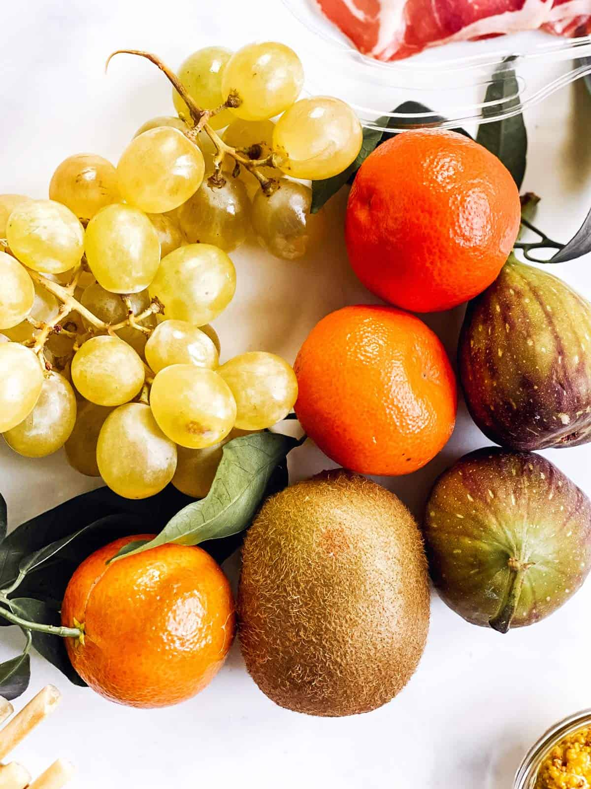 several types of fruit on bright white surface