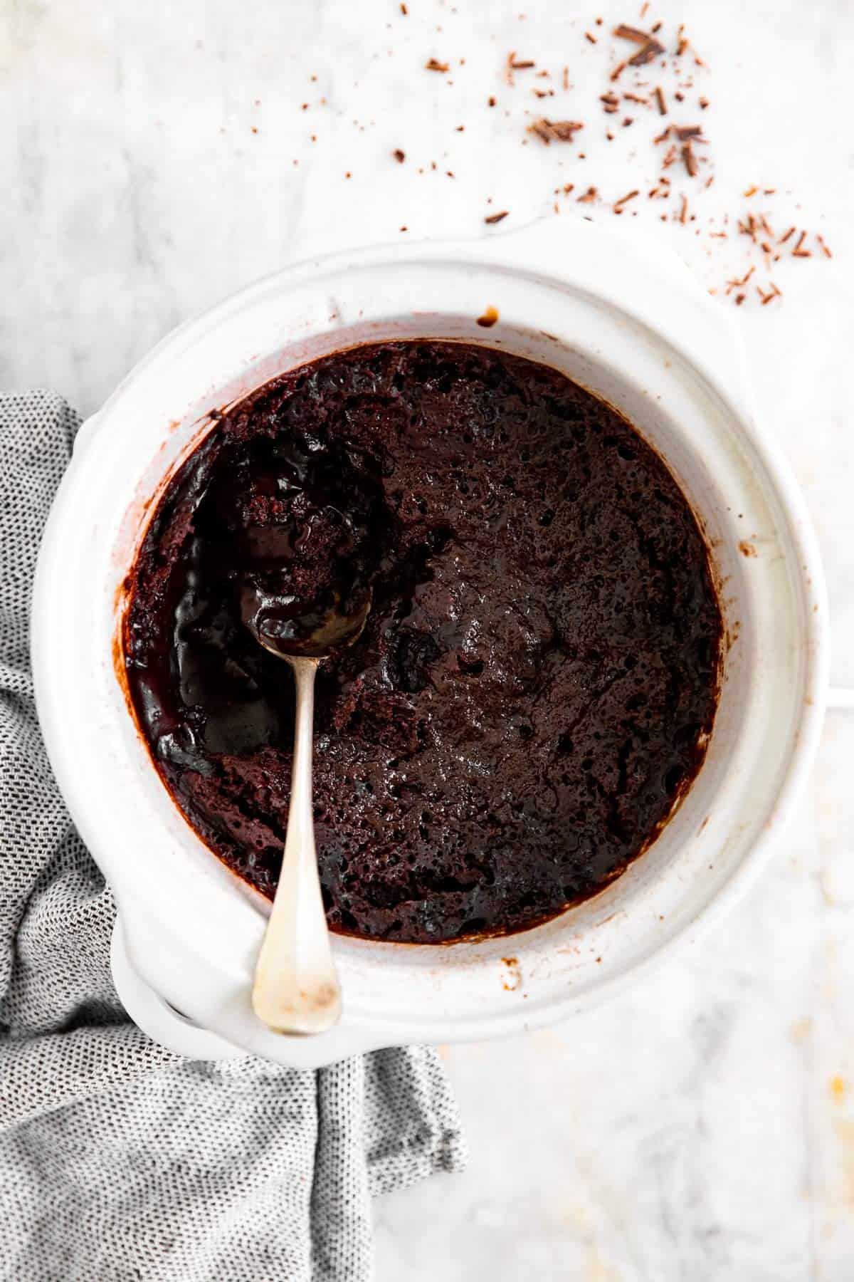 overhead view of white crock with chocolate pudding cake