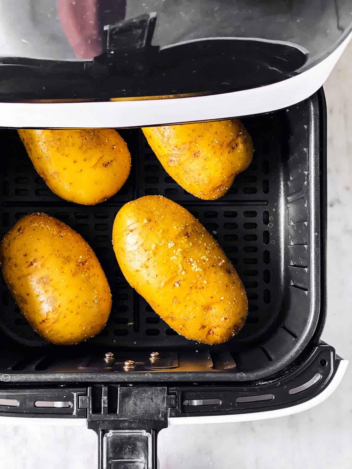 raw russet potatoes in air fryer basket