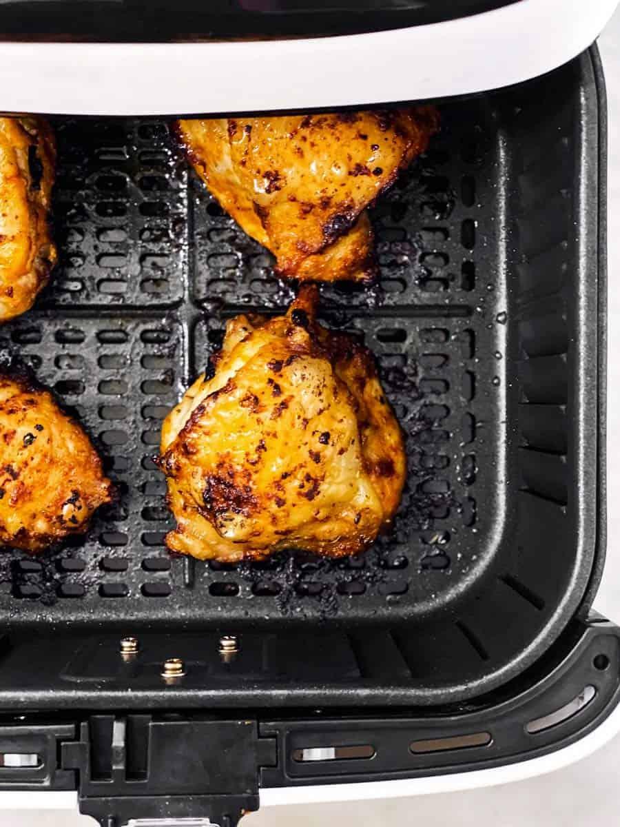 crispy chicken thighs in air fryer basket