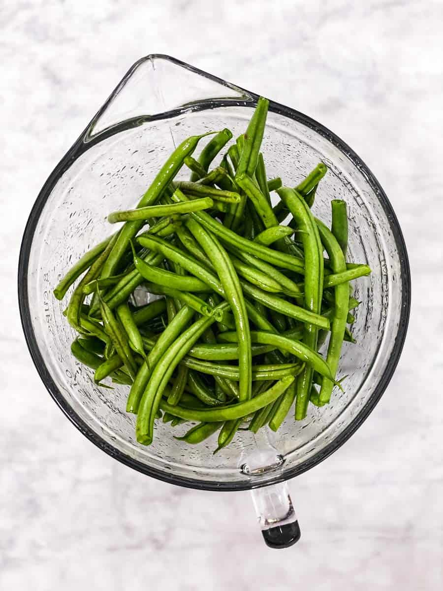 glass bowl with raw green beans