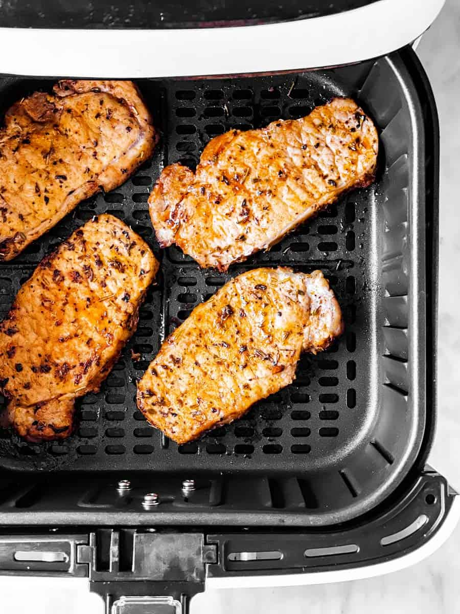 cooked pork chops in air fryer basket