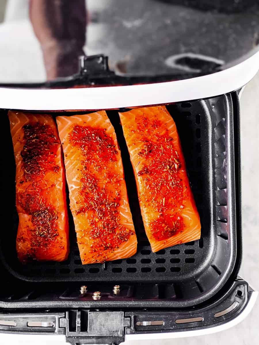 raw salmon in air fryer basket