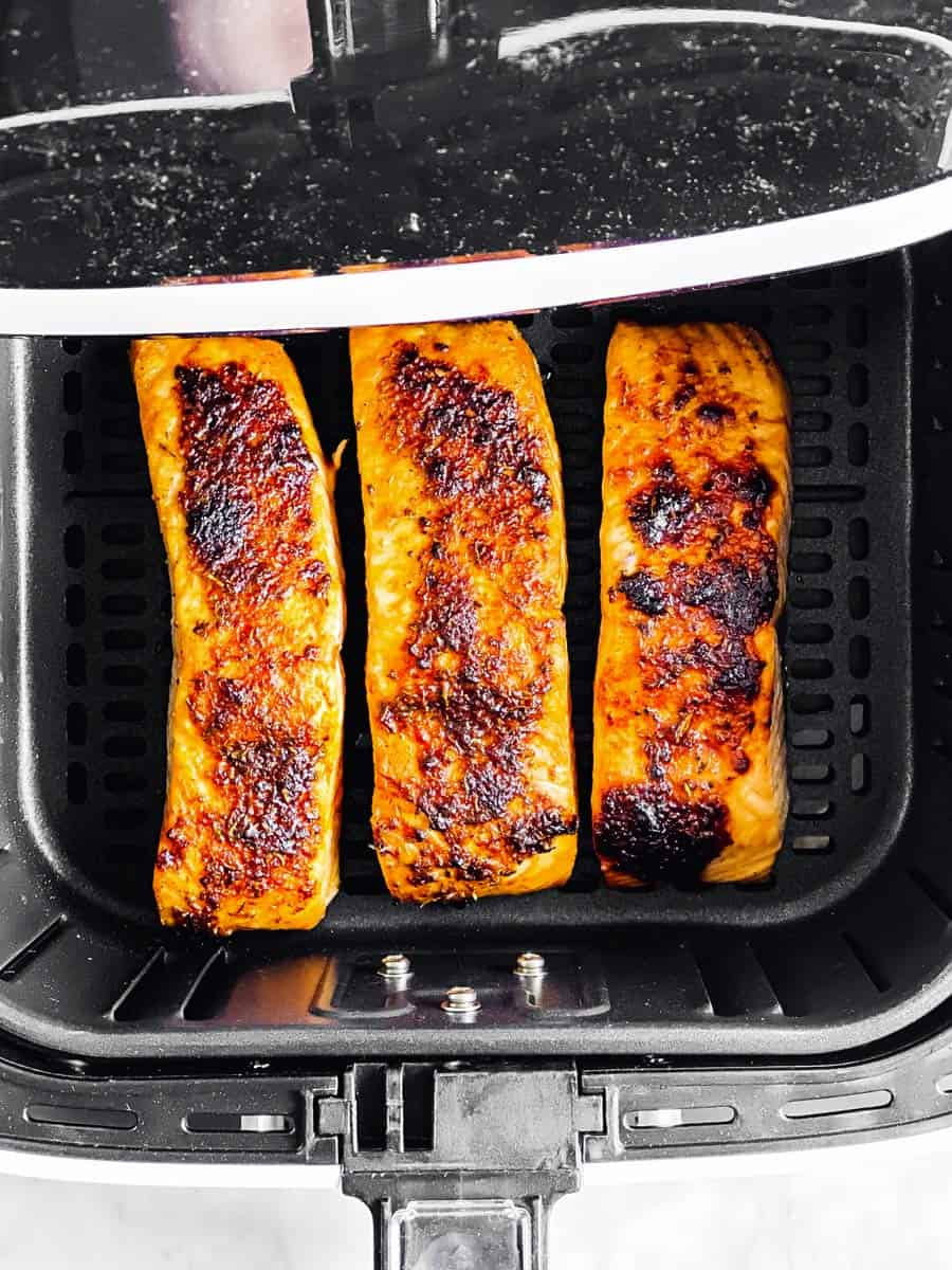 cooked salmon in air fryer basket