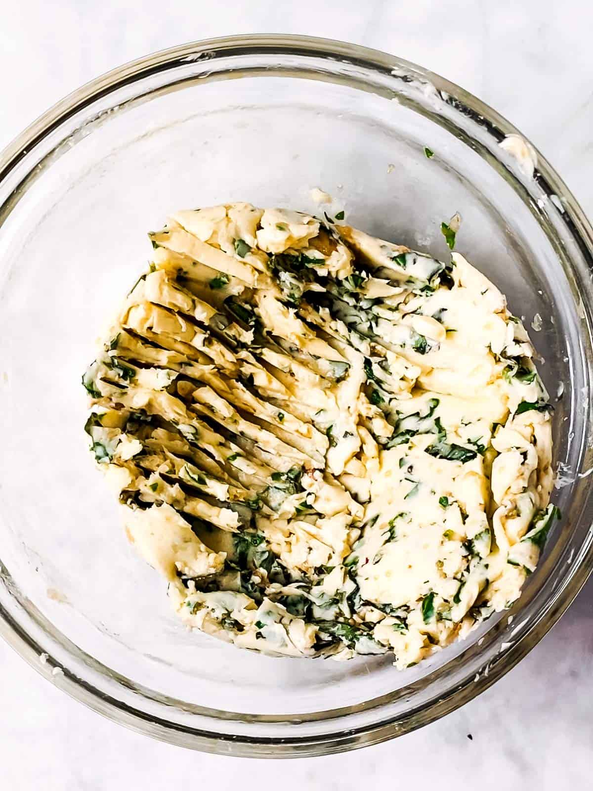 glass bowl with garlic herb butter