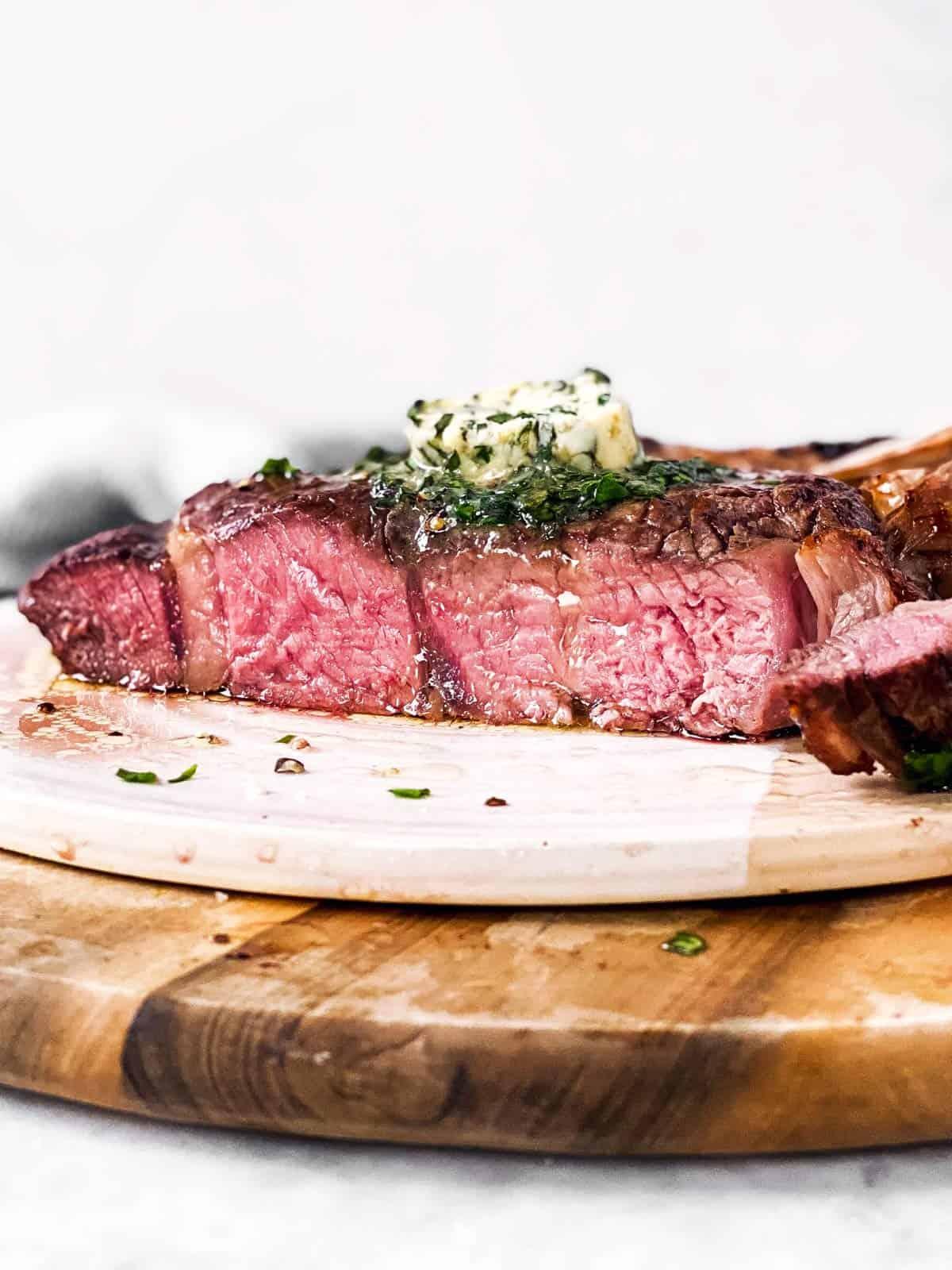 sliced open steak on platter