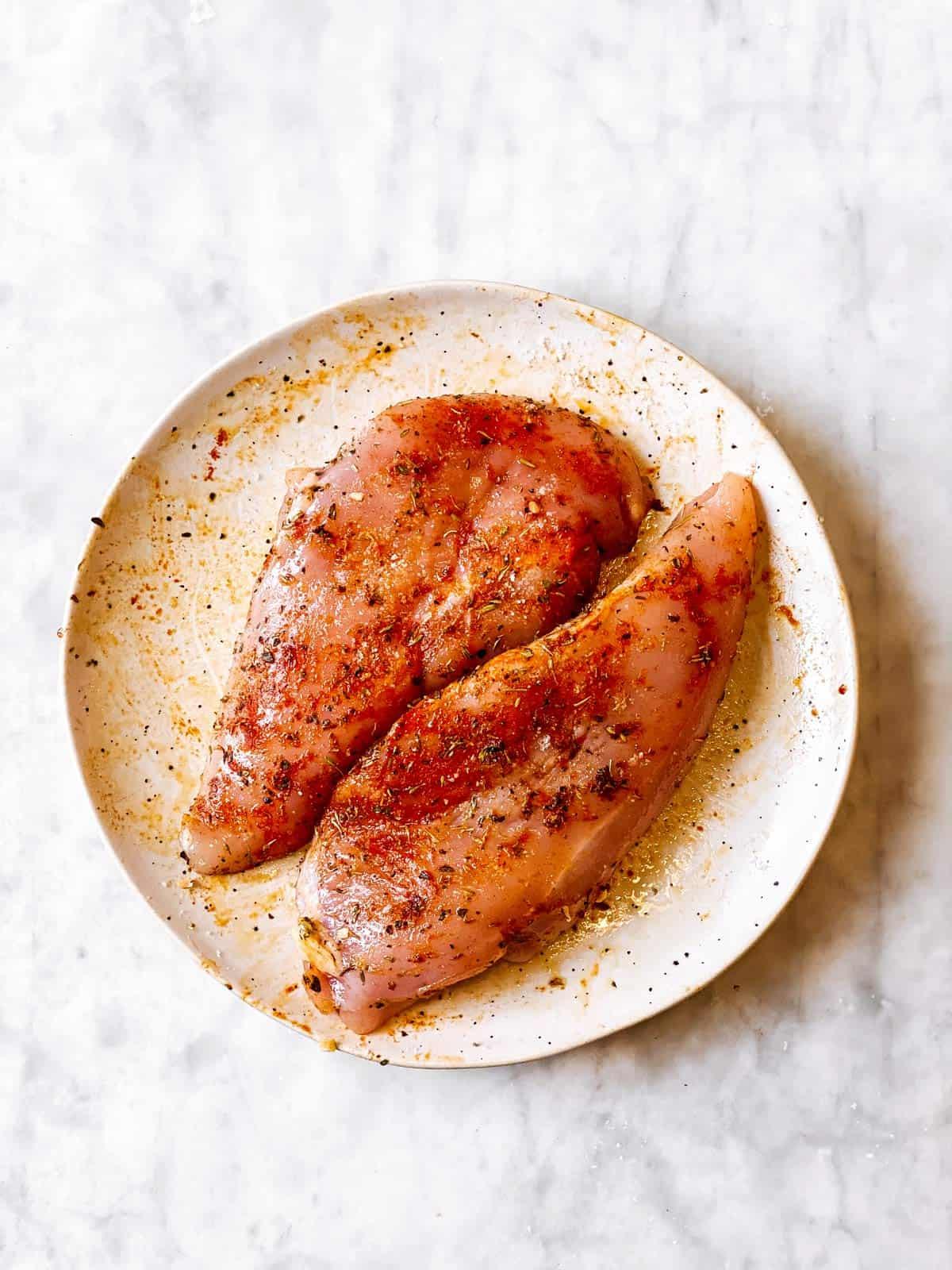 seasoned chicken breasts on white plate
