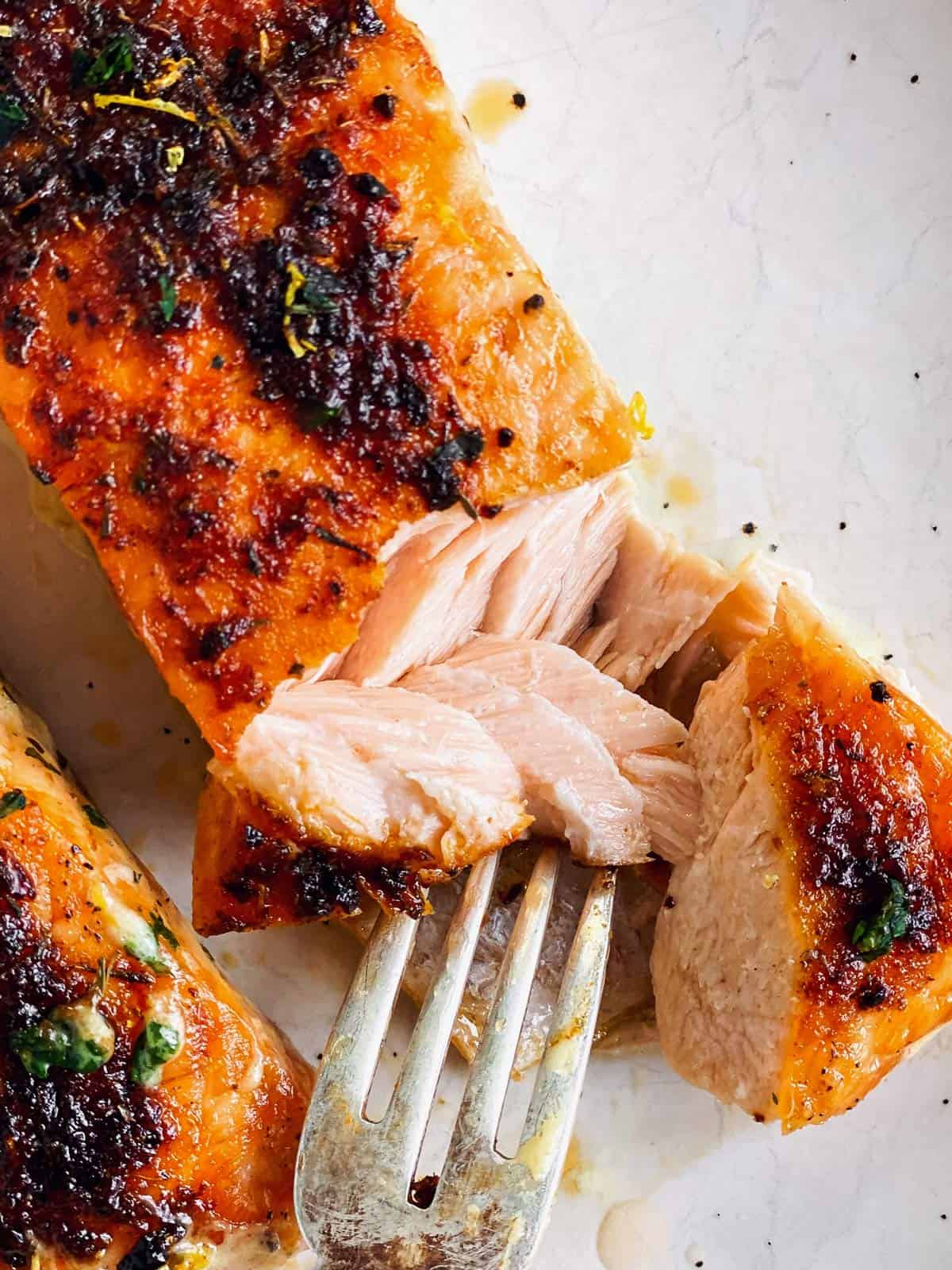 close up of halved cooked salmon fillet