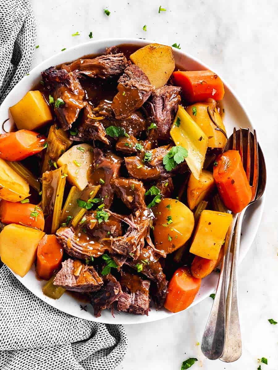 white serving platter with slow cooker pot roast