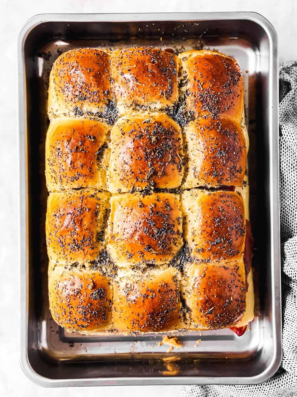 baked hot ham sliders in metal pan