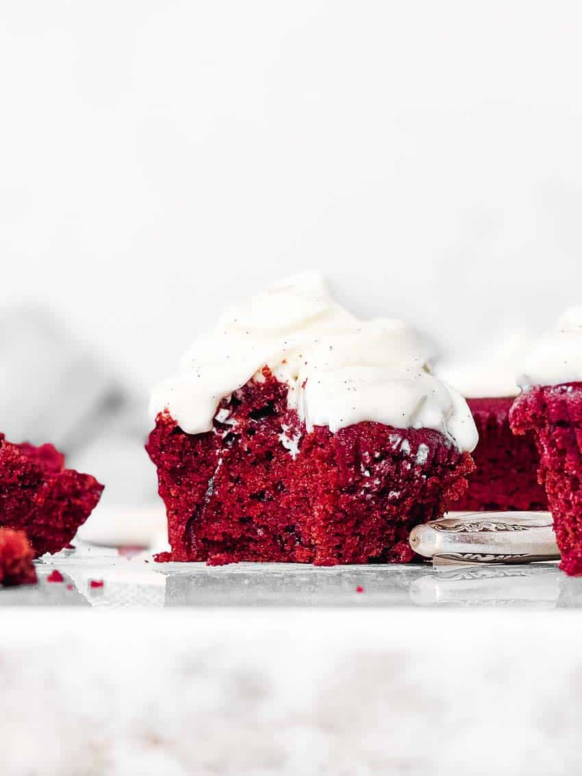 red velvet cupcake with bite taken out