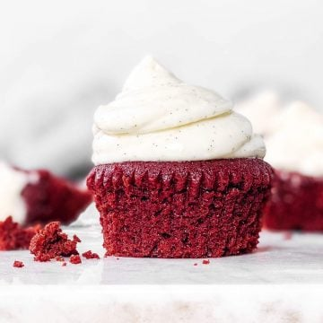 red velvet cupcake with cream cheese frosting on countertop