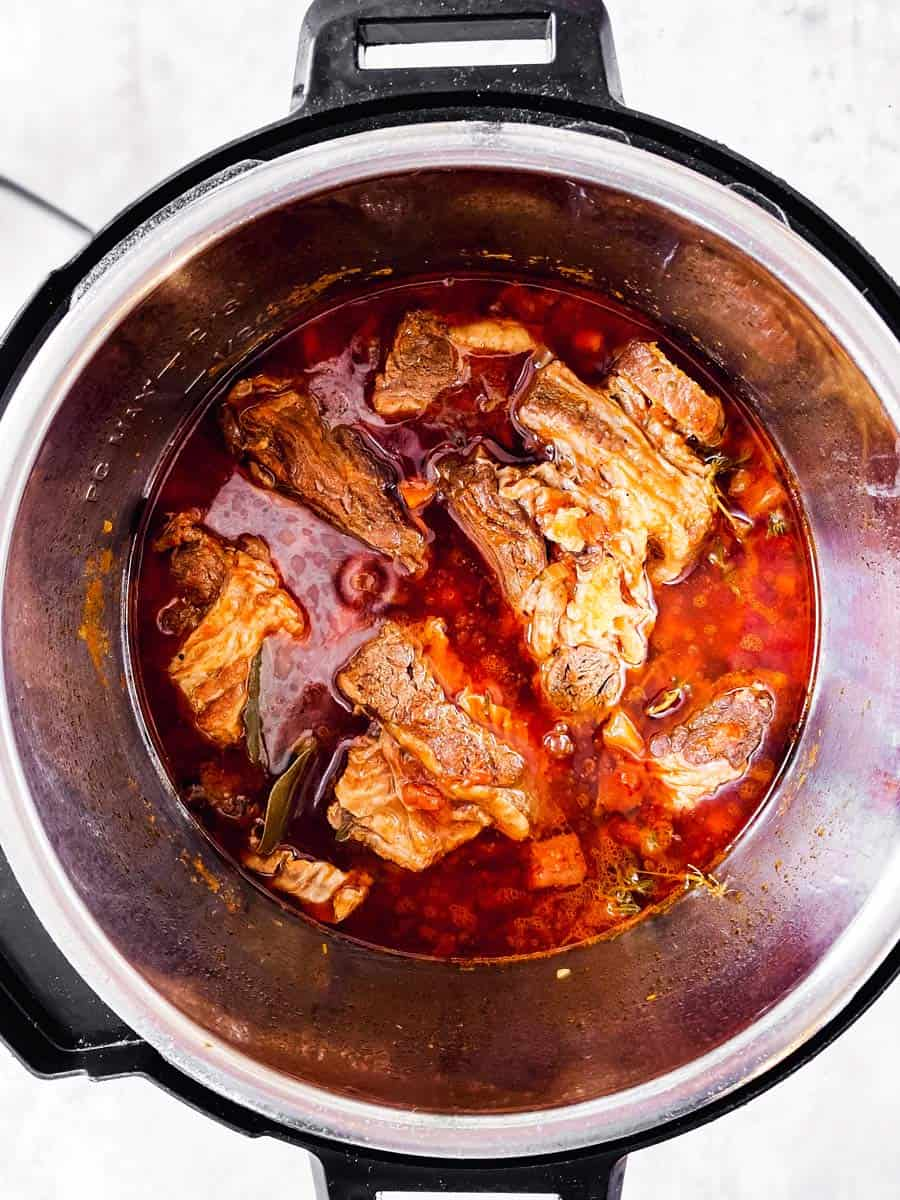 overhead view of instant pot with cooked short ribs