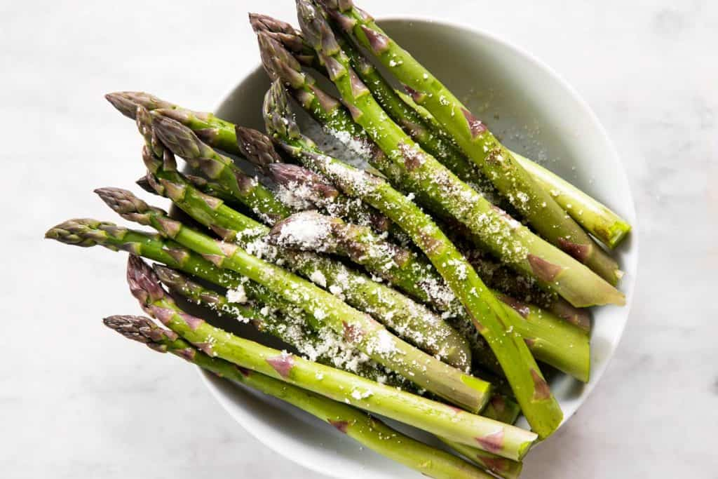 asparagus seasoned with olive oil, salt, pepper and parmesan cheese