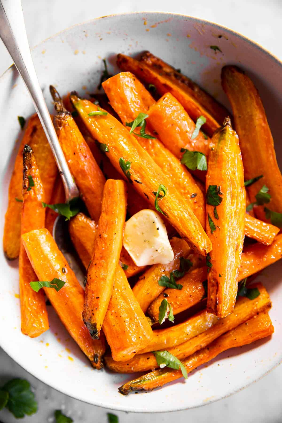 overhead close up of air fryer carrots in white bowl