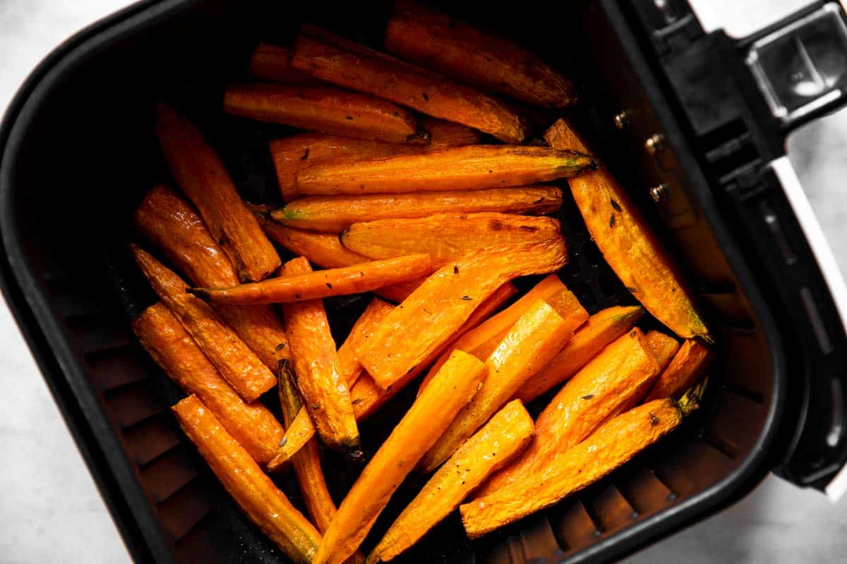 cooked carrots in air fryer basket