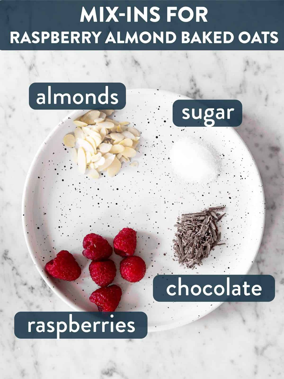 mix-ins for raspberry baked oats on white plate with text labels