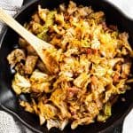 bacon braised cabbage in black cast iron skillet