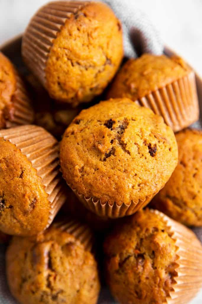 close up photo of carrot muffins on plate
