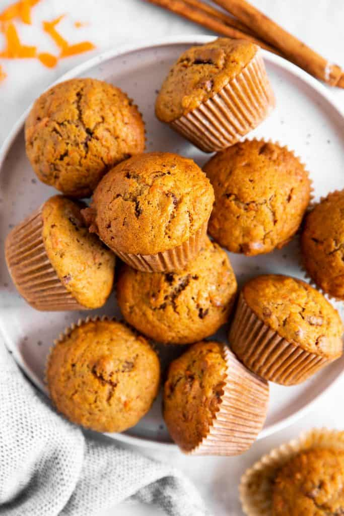 several carrot muffins on white plate