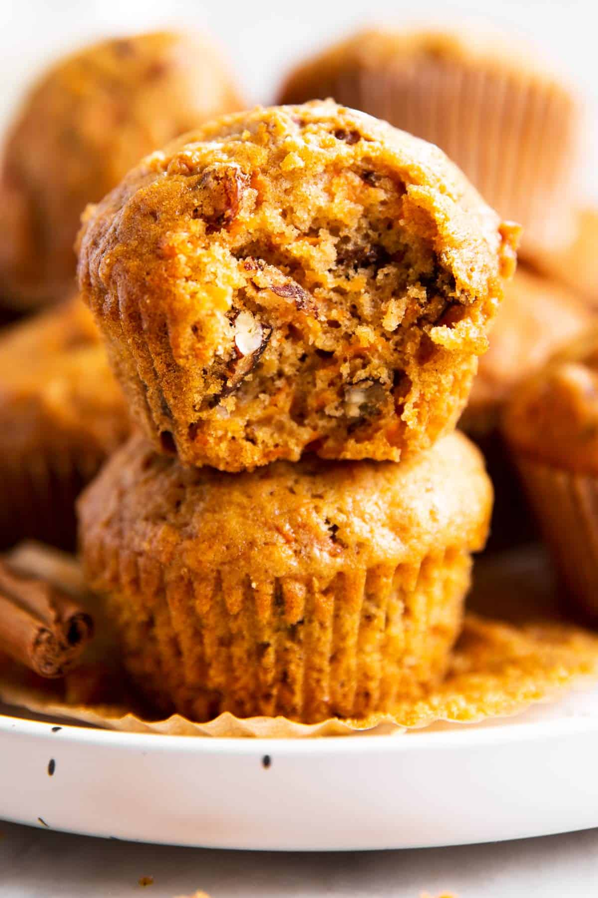 stack of carrot muffins on white plate