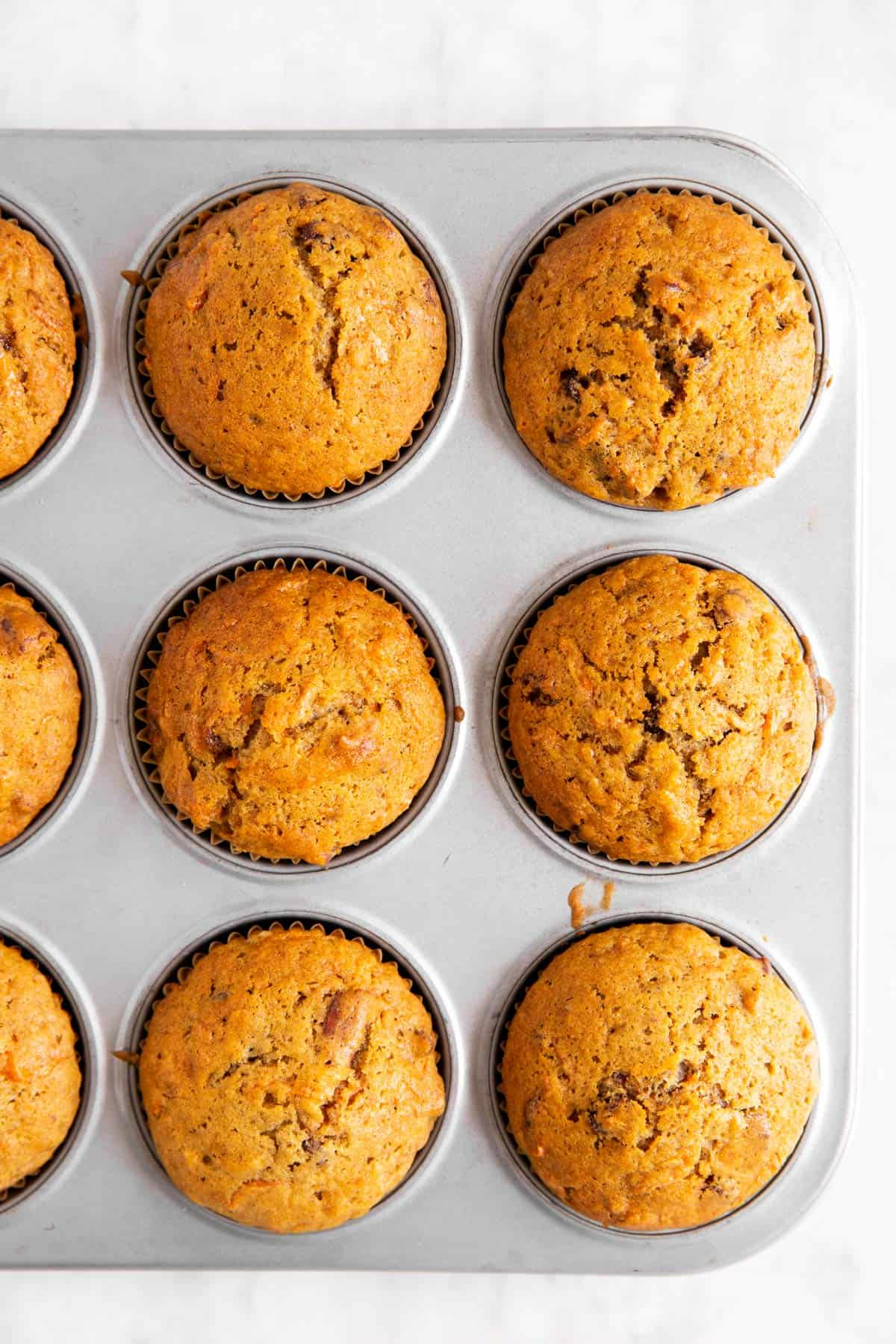 overhead view of carrot muffins in muffin pan