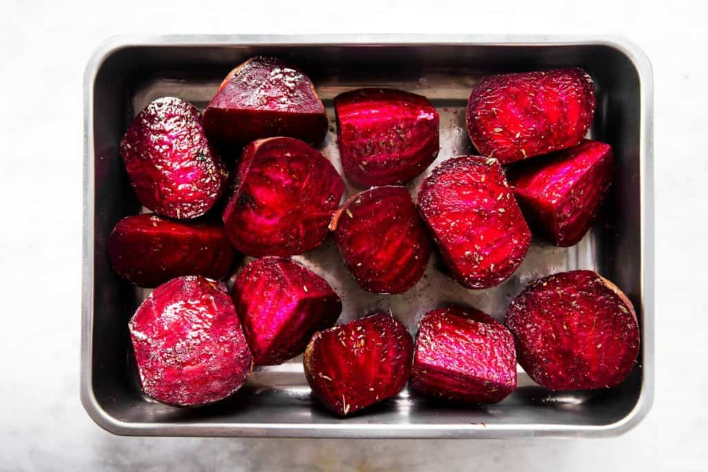 beets in roasting pan with oil and seasoning