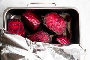 covering beets in roasting pan with foil