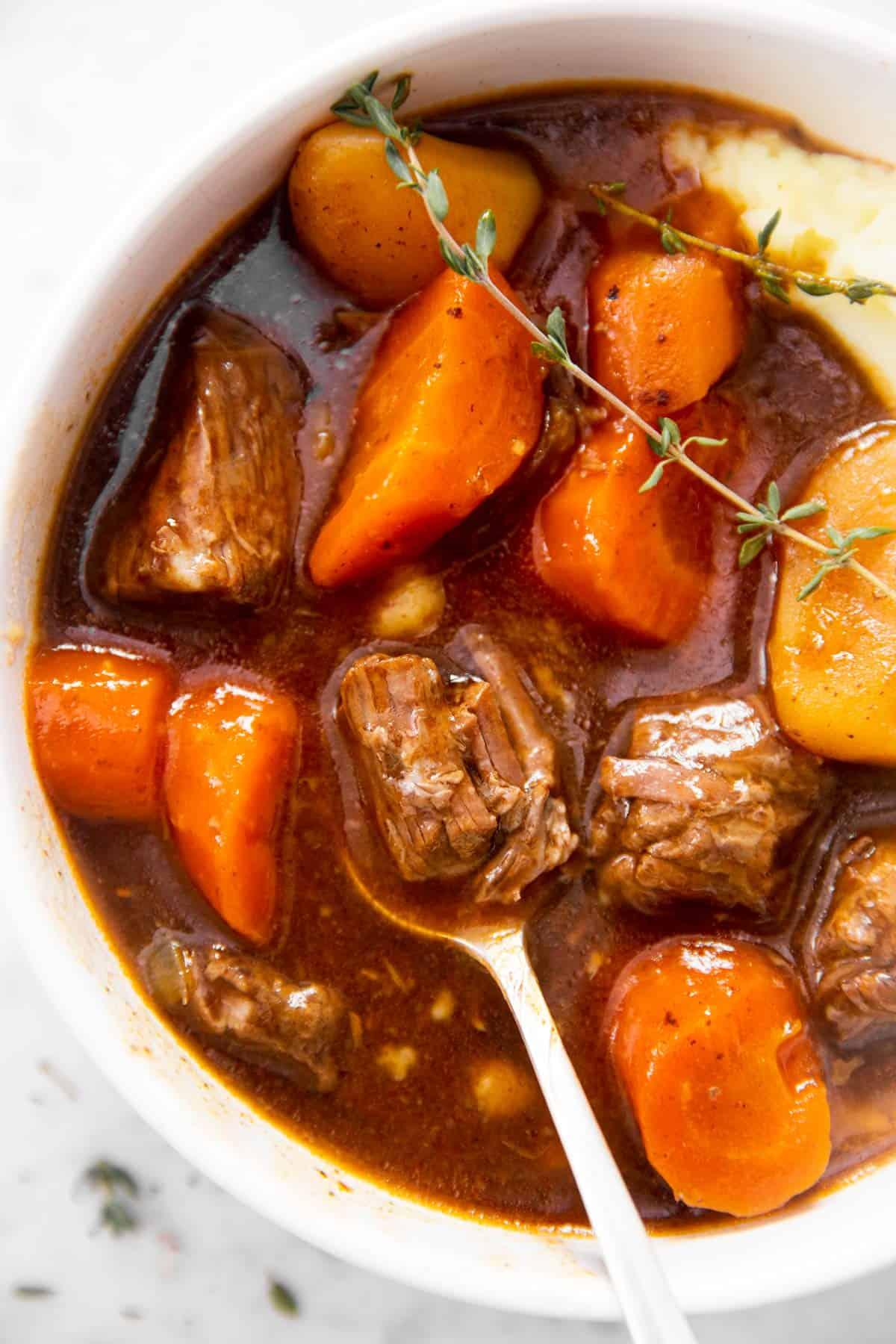 close up photo of spoon in Irish stew