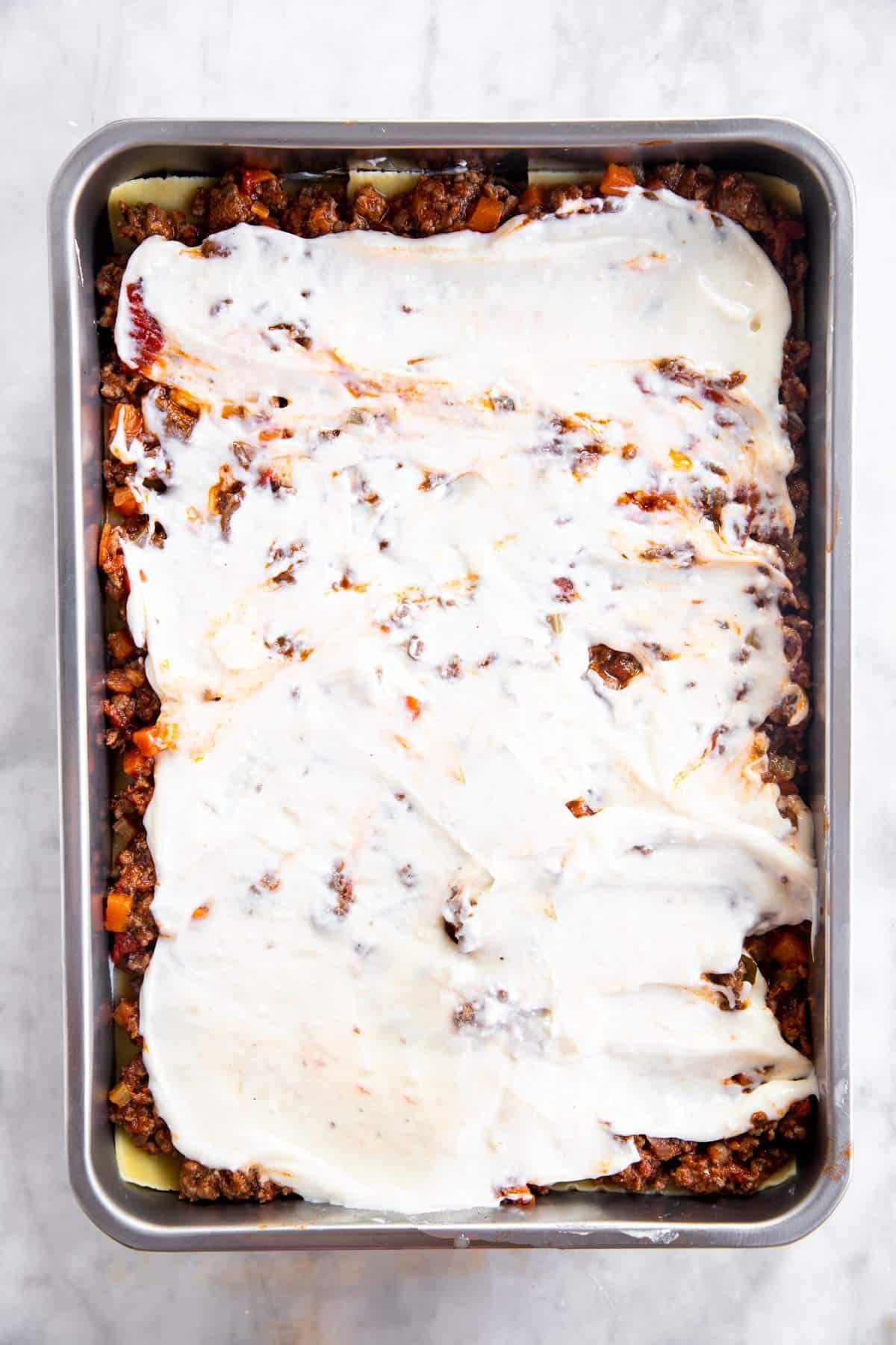third layer of béchamel sauce in lasagna