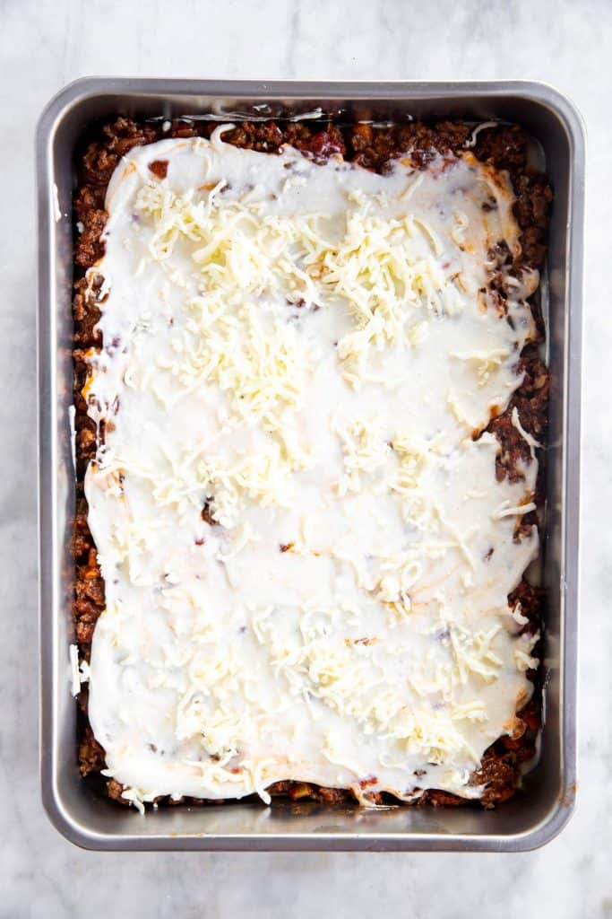 casserole dish with first layer of lasagna assembled