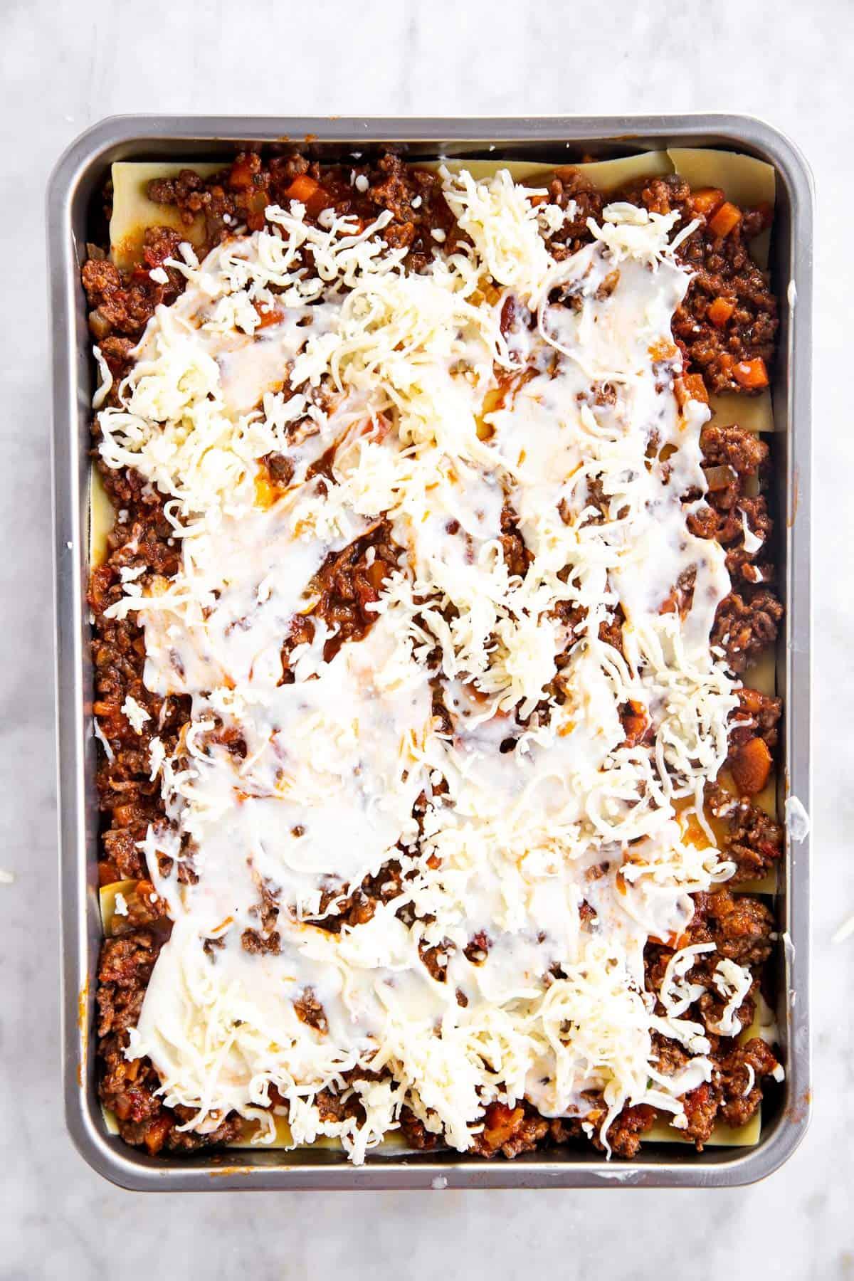 casserole dish with third layer of béchamel sauce