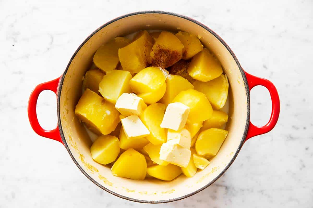pot with cooked potatoes with butter and milk