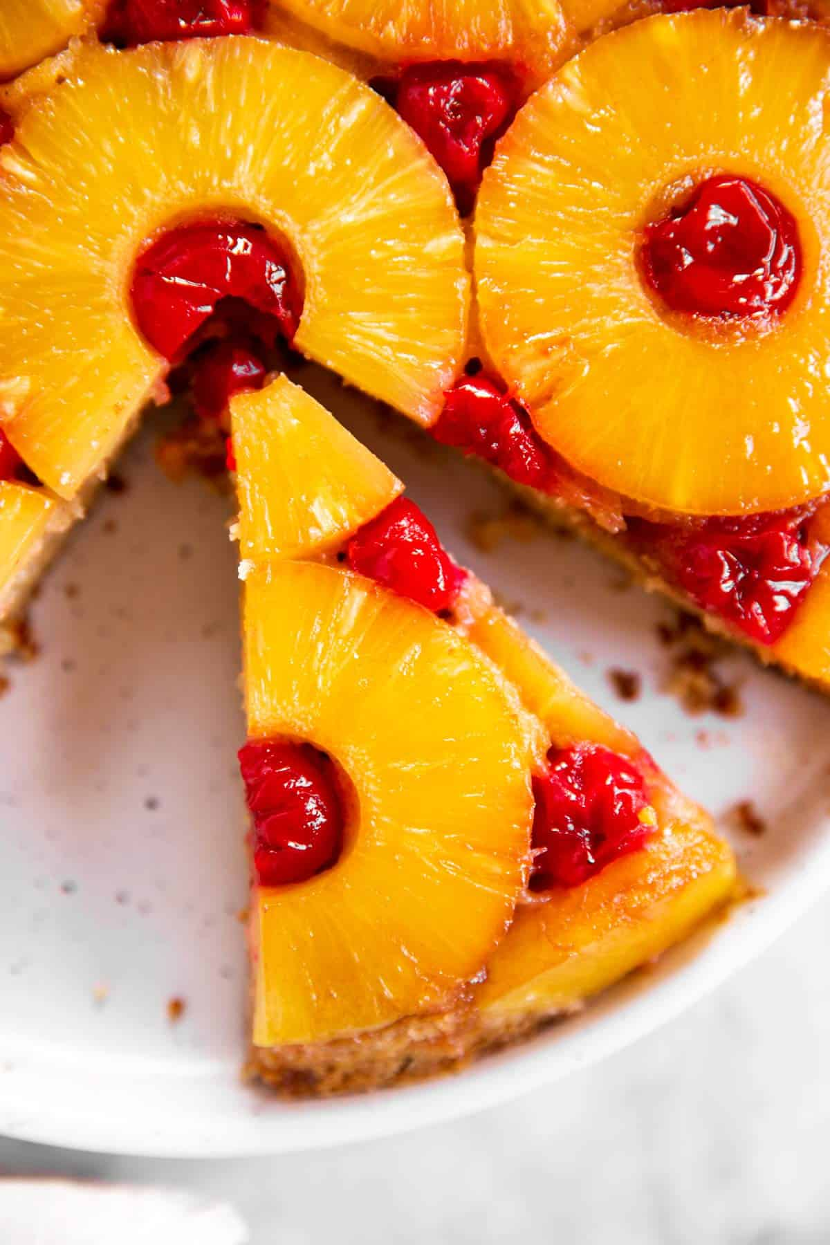 close up photo of a slice of pineapple upside down cake