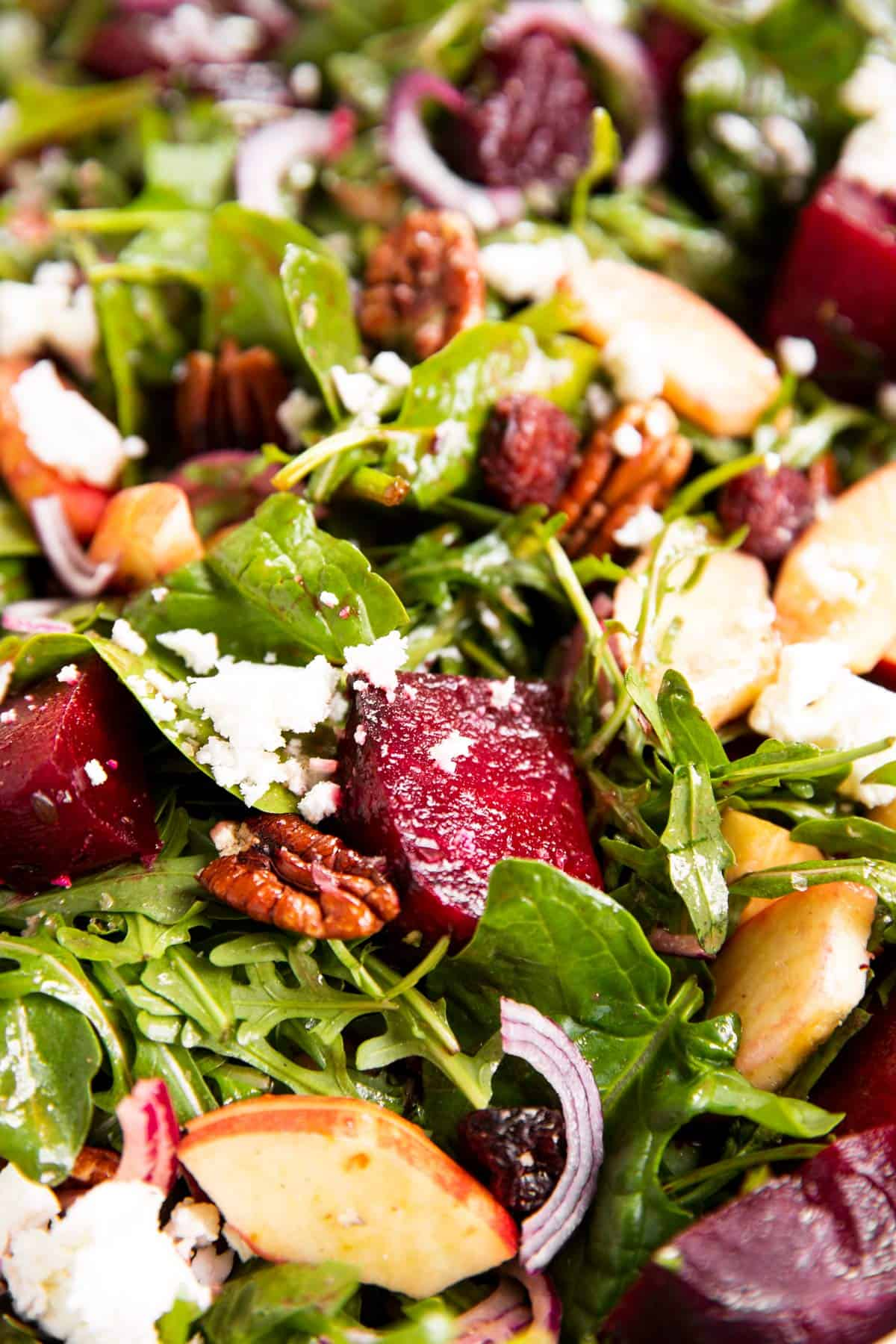 close up photo of roasted beet salad with goat's cheese