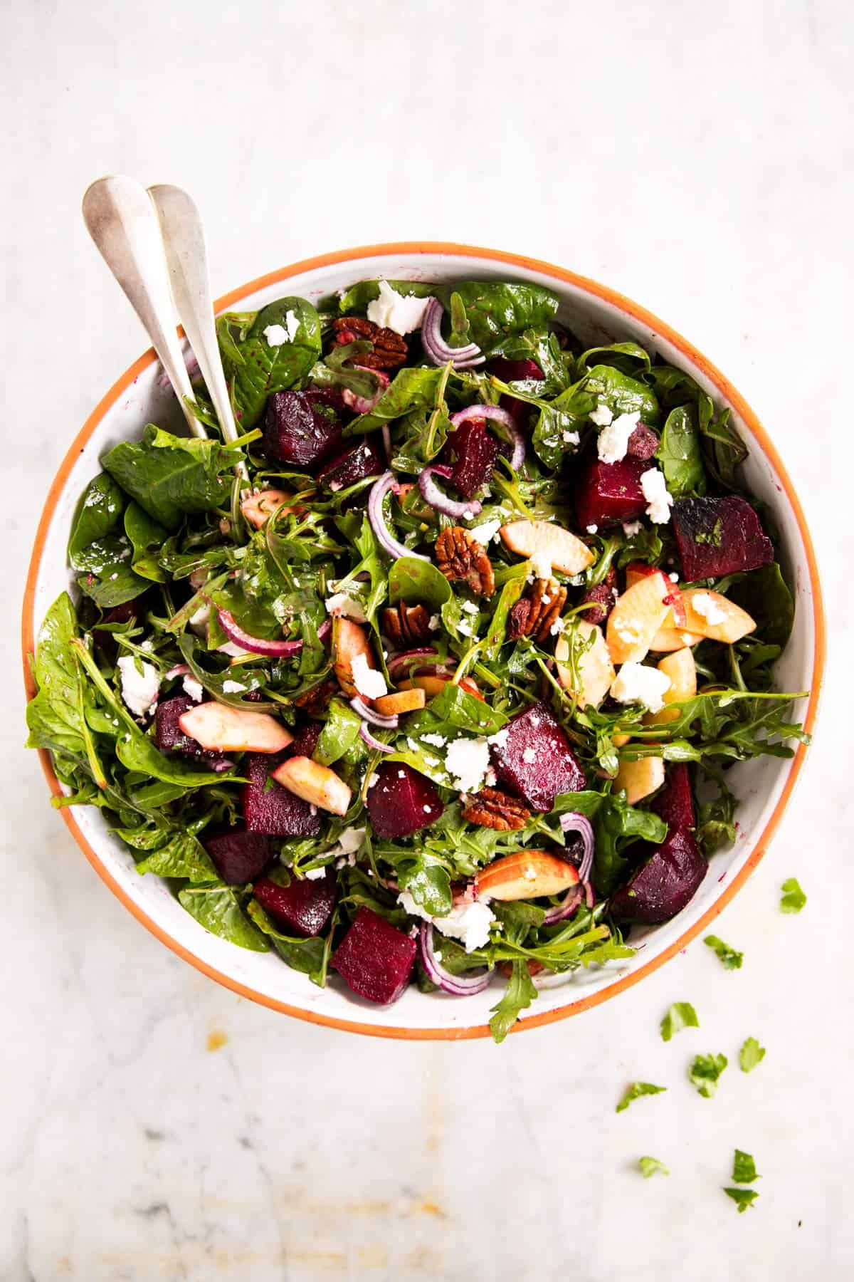overhead view of salad bowl with roasted beet salad