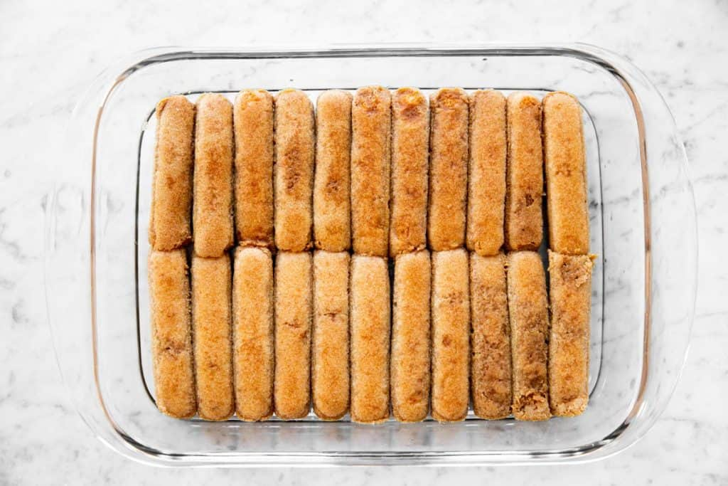 pan lined with coffee-soaked ladyfinger biscuits
