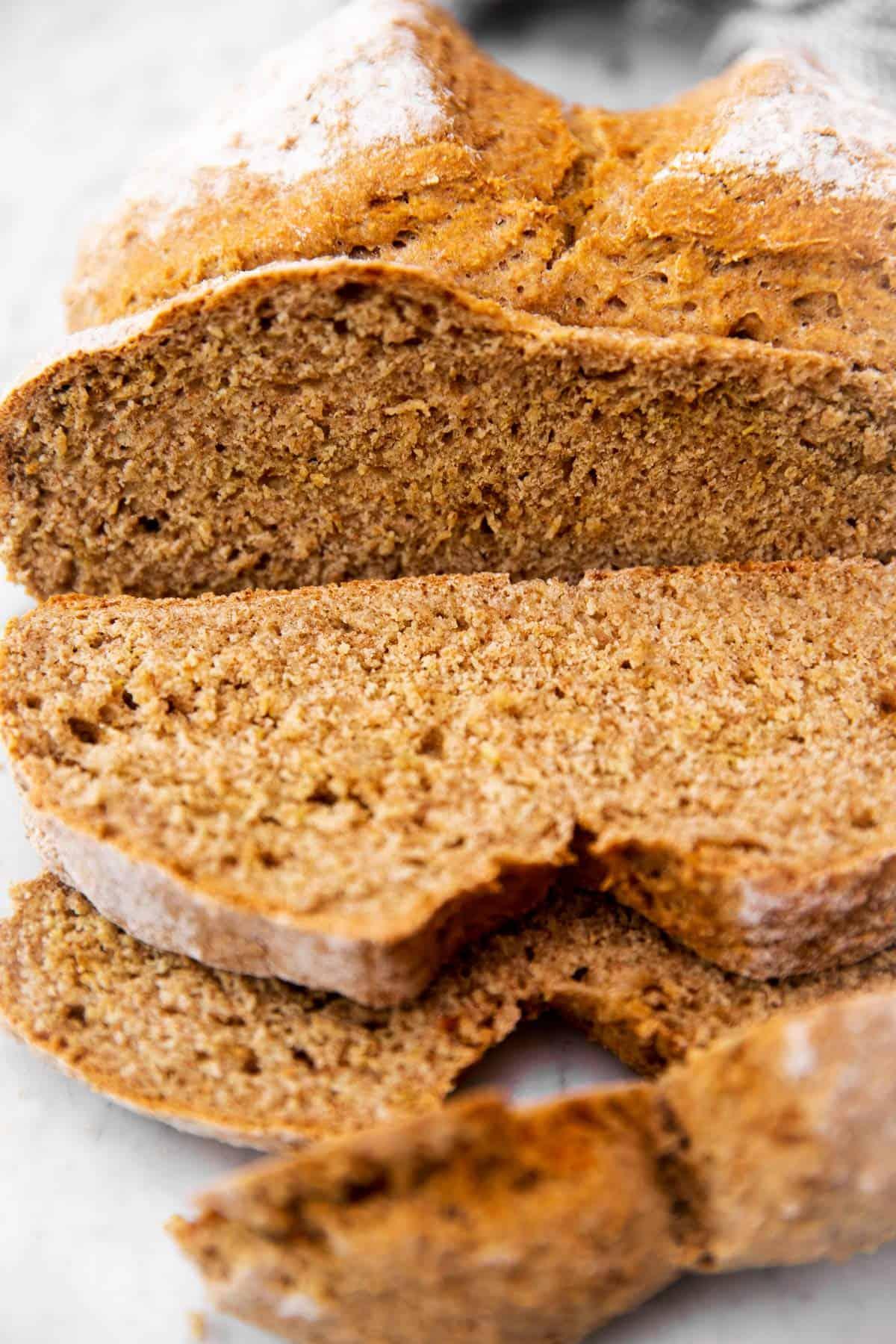 Irish soda bread with a few slices sliced off