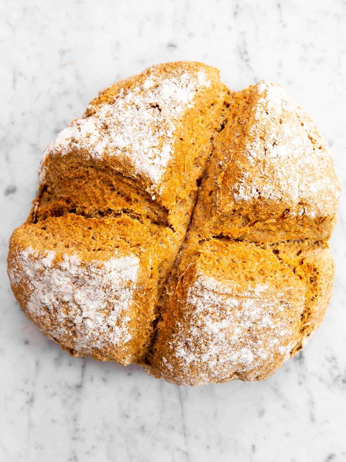 baked Irish soda bread on marble surface