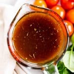 overhead view of balsamic vinaigrette dressing in glass measuring jug