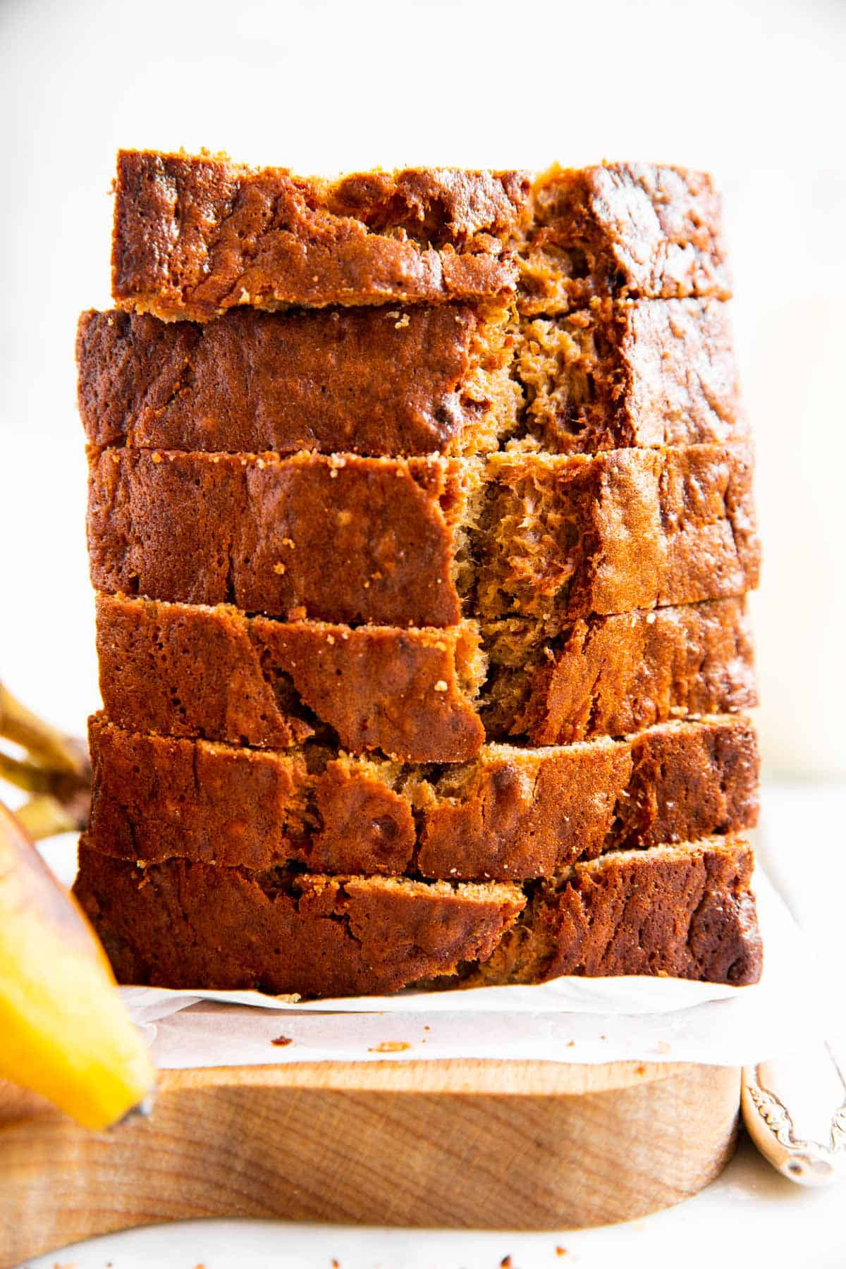 stack of sliced banana bread on wooden board