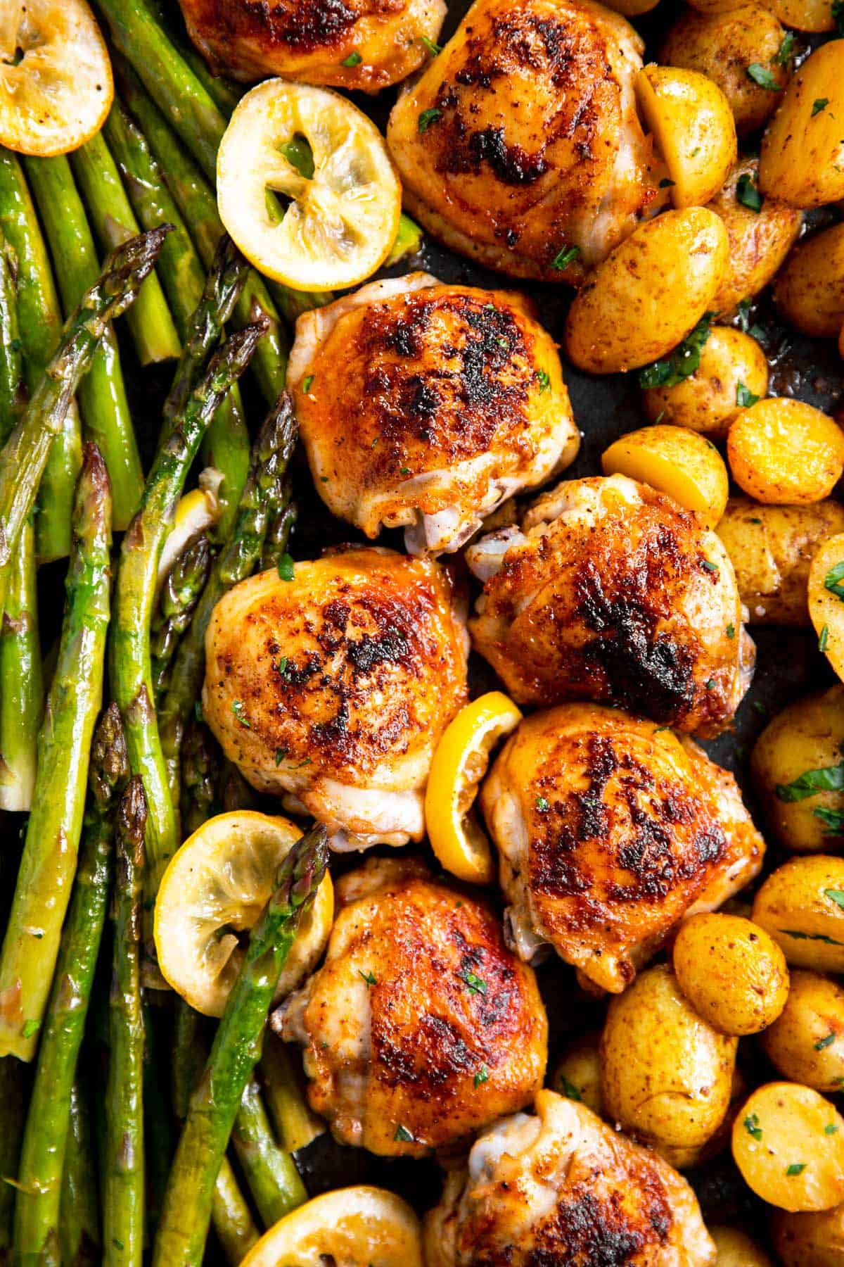 close up photo of chicken and asparagus sheet pan dinner