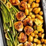 sheet pan with roasted chicken thighs, asparagus and potatoes