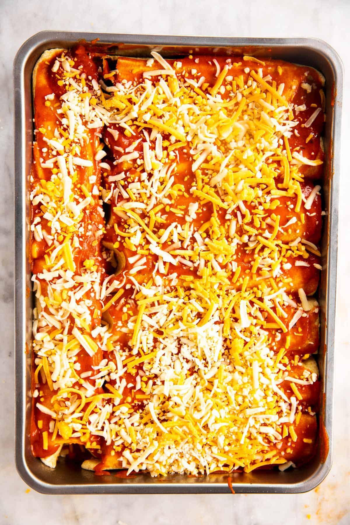 unbaked chicken enchiladas in casserole dish