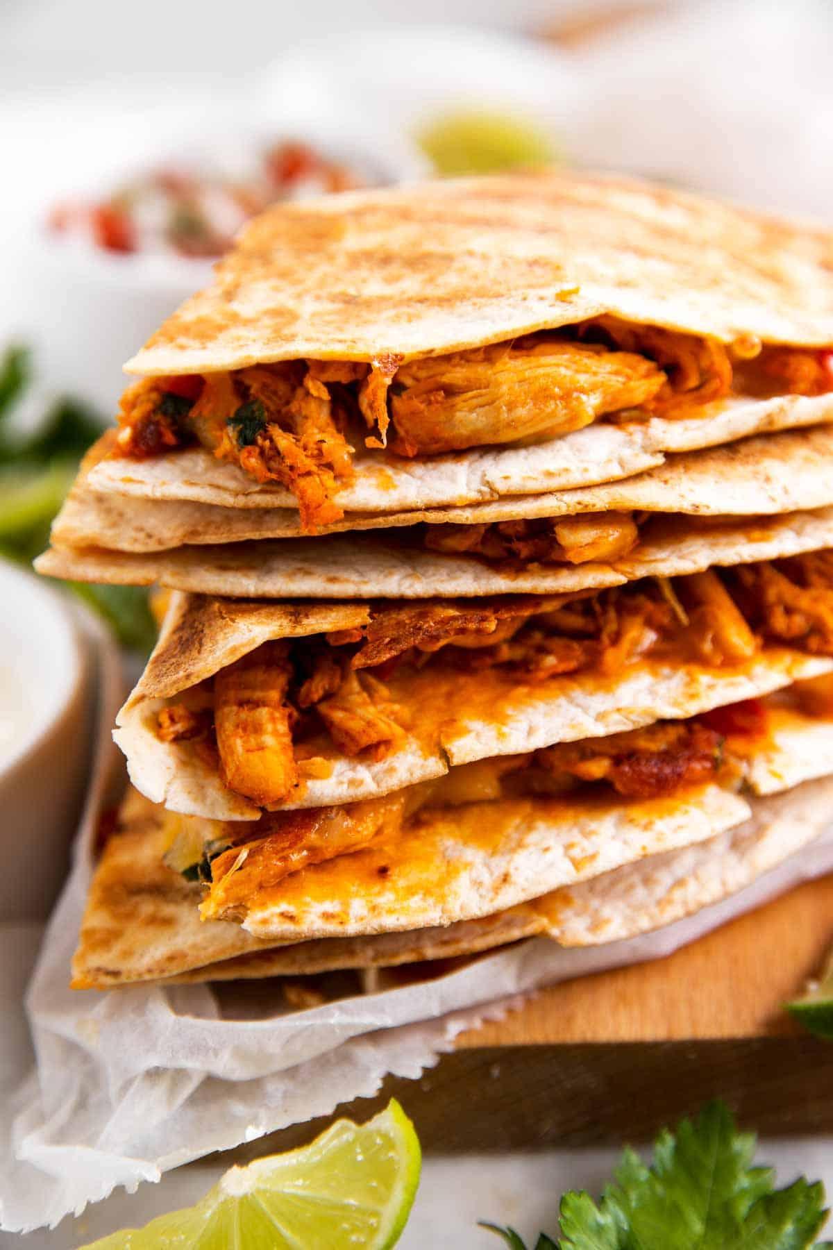 stack of chicken quesadillas on wooden board