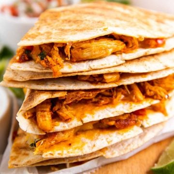 stack of chicken quesadillas on wooden board
