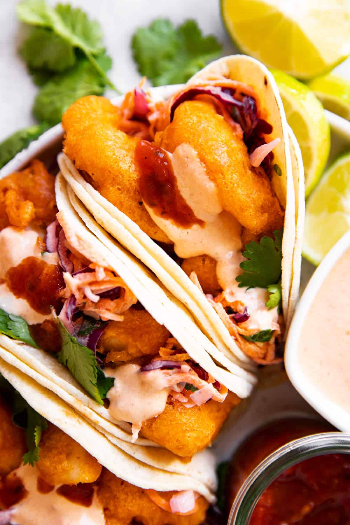 close up photo of fish tacos with chipotle mayo
