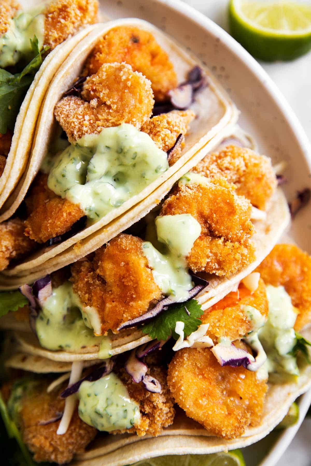 overhead view of shrimp tacos together on white plate