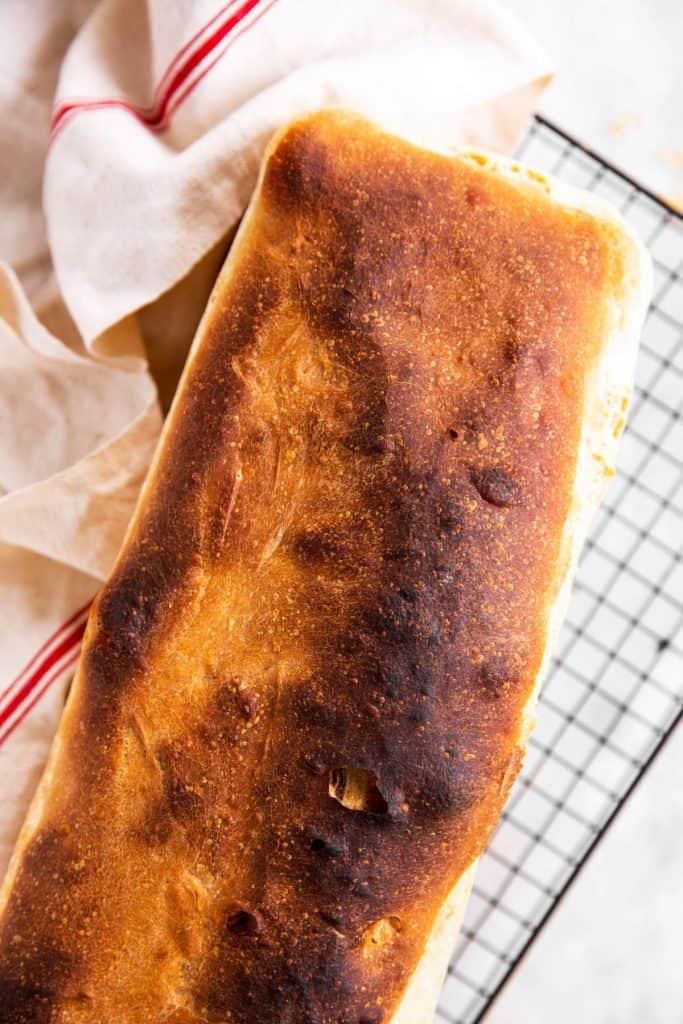baked sourdough bread on cooling rack